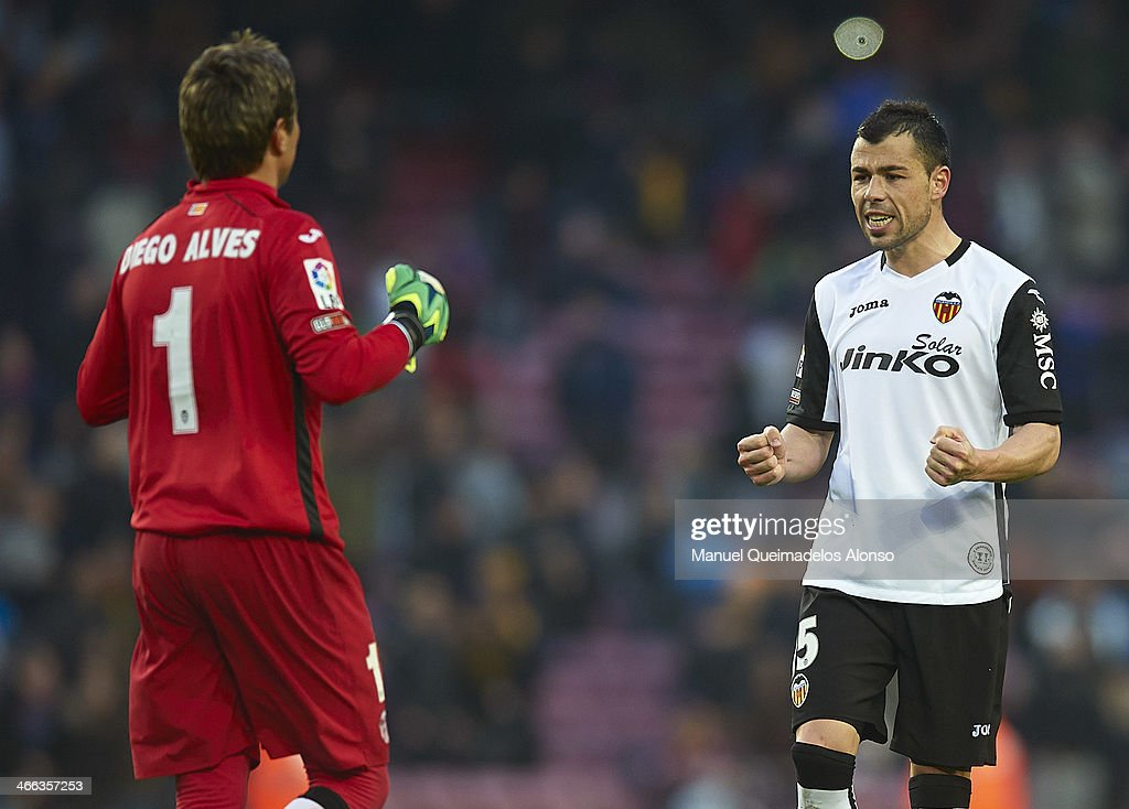 Diego Alves of Valencia CF celebrates scoring with his teammate Javi Fuego (R) during the La Liga match between FC Barcelona and Valencia CF at Camp Nou on February 1, 2014 in Barcelona, Spain.