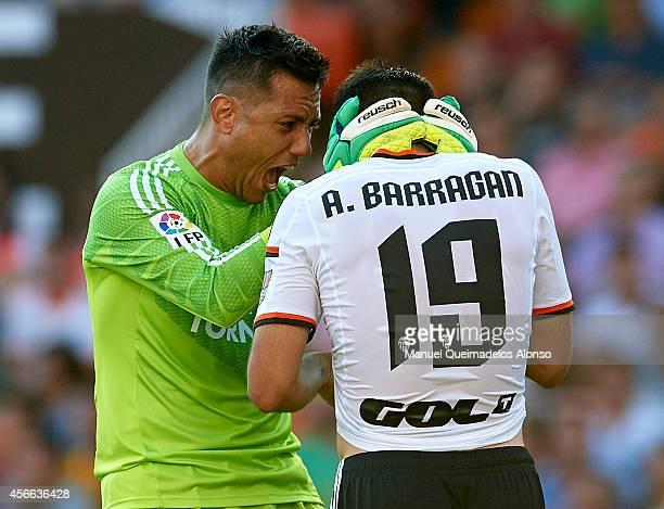 Diego Alves of Valencia reacts to his teammate Antonio Barragan during the La Liga match between Valencia CF and Club Atletico de Madrid at Estadi de...