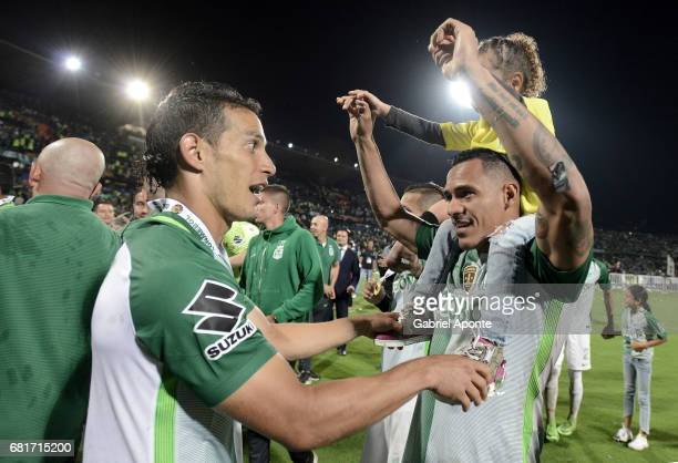 Diego Arias and Aldo Ramirez of Nacional celebrate after winning a match between Atletico Nacional and Chapecoense as part of CONMEBOL Recopa...