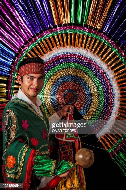Diego Armando Gonzalez Romero poses for a photograph with his 'Penacho' during the presentation of the Huey Atlixcayotl Festival on September 29 2018...