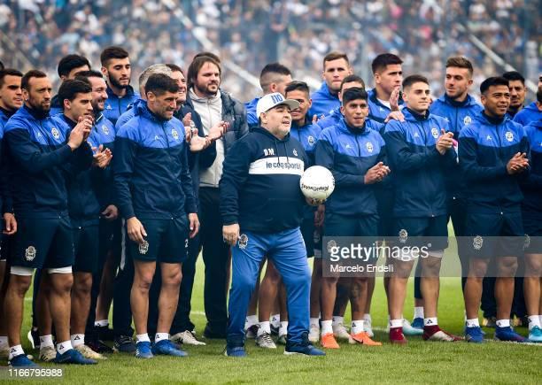 Diego Armando Maradona cheers with his team players during his presentation as new coach of Gimnasia y Esgrima La Plata at Juan Carmelo Zerillo...