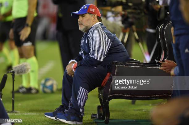 Diego Armando Maradona coach of Gimnasia looks on to him during a match between Newell's Old Boys and Gimnasia y Esgrima La Plata at Marcelo Bielsa...