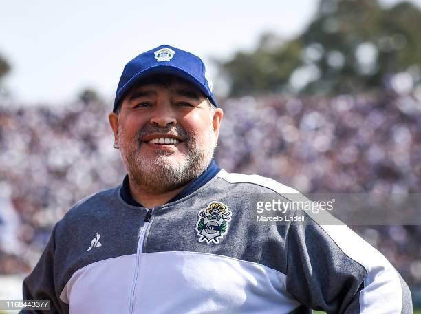 Diego Armando Maradona coach of Gimnasia y Esgrima La Plata smiles before a match between Gimnasia y Esgrima La Plata and Racing Club as part of...