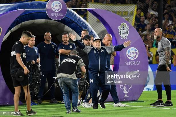 Diego Armando Maradona head Coach of Gimnasia y Esgrima enters the pitch prior to a match between Boca Juniors and Gimnasia y Esgrima La Plata as...