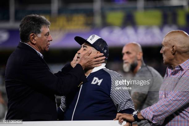 Diego Armando Maradona Head Coach of Gimnasia y Esgrima greets Miguel Brindisi and Hugo Perotti during a tribute prior a match between Boca Juniors...