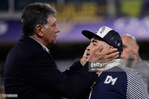 Diego Armando Maradona head Coach of Gimnasia y Esgrima greets Miguel Brindisi prior to a match between Boca Juniors and Gimnasia y Esgrima La Plata...