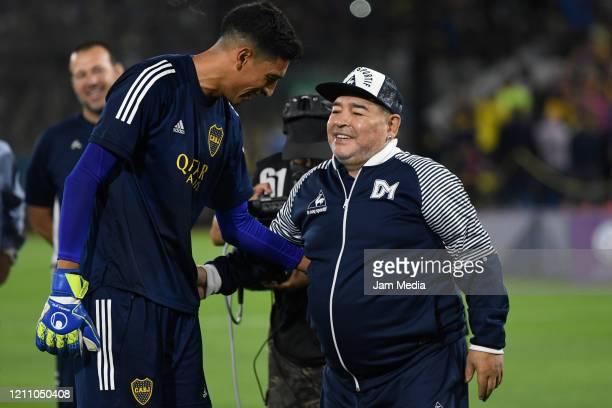Diego Armando Maradona head Coach of Gimnasia y Esgrima greets Esteban Andrada of Boca Juniors during a match between Boca Juniors and Gimnasia y...