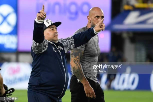 Diego Armando Maradona head Coach of Gimnasia y Esgrima greets the fans prior to a match between Boca Juniors and Gimnasia y Esgrima La Plata as part...