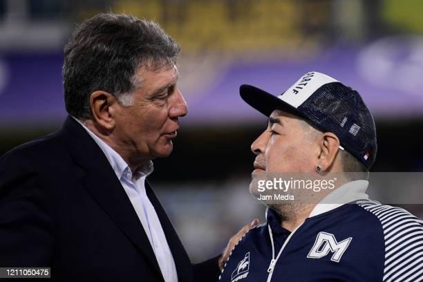 Diego Armando Maradona Head Coach of Gimnasia y Esgrima greets with Miguel Brindisi during s tribute prior a match between Boca Juniors and Gimnasia...