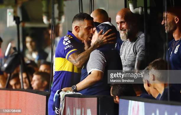 Diego Armando Maradona head coach of Gimnasia y Esgrima La Plata and Carlos Tevez of Boca Juniors kiss before a match between Boca Juniors and...