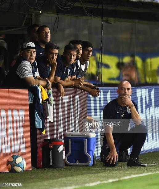Diego Armando Maradona head coach of Gimnasia y Esgrima La Plata and Sebastian Mendez assistant coach react during a match between Boca Juniors and...