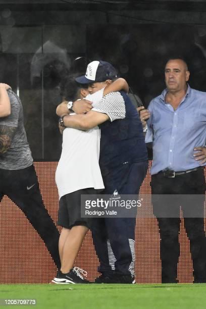 Diego Armando Maradona head coach of Gimnasia y Esgrima La Plata hugs his grandson Benjamin Agüero Maradona prior to a match between Boca Juniors and...