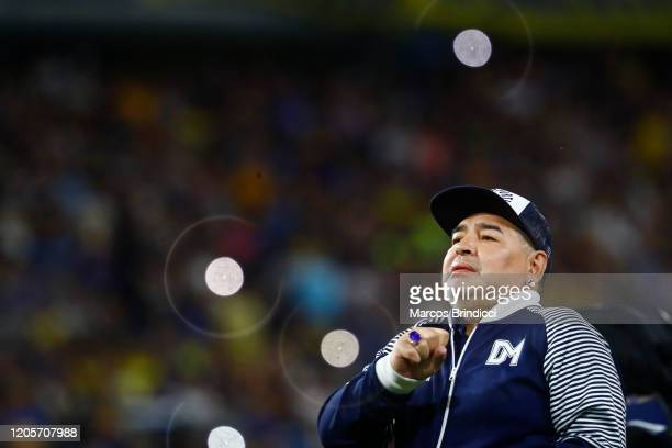 Diego Armando Maradona head coach of Gimnasia y Esgrima La Plata greets fans prior to a match between Boca Juniors and Gimnasia y Esgrima La Plata as...
