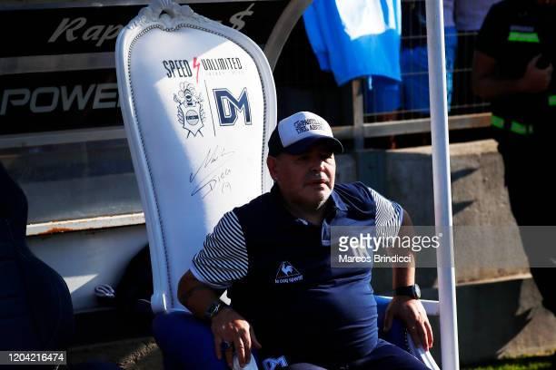 Diego Armando Maradona head coach of Gimnasia y Esgrima La Plata sits on the bench before a match between Gimnasia y Esgrima La Plata and Atletico...