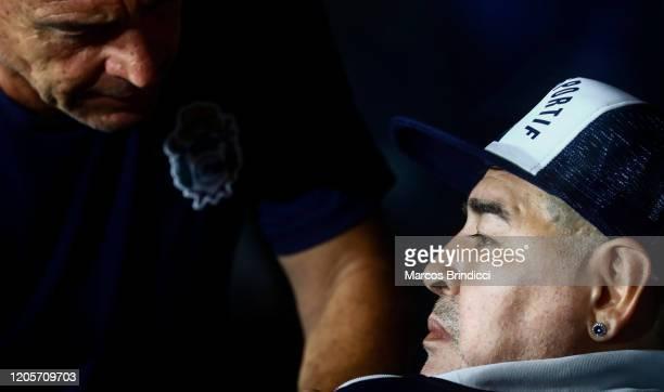 Diego Armando Maradona head coach of Gimnasia y Esgrima La Plata sits on the bench before a match between Boca Juniors and Gimnasia y Esgrima La...