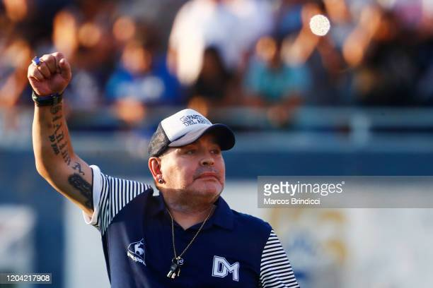 Diego Armando Maradona head coach of Gimnasia y Esgrima La Plata gestures to supporters during a match between Gimnasia y Esgrima La Plata and...