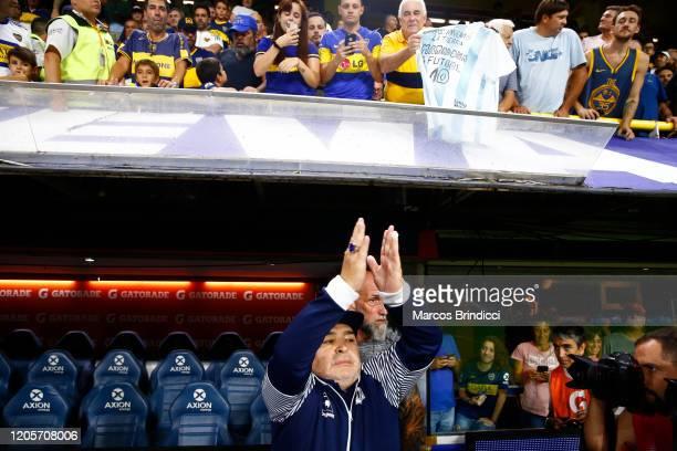 Diego Armando Maradona head coach of Gimnasia y Esgrima La Plata waves to fans prior to a match between Boca Juniors and Gimnasia y Esgrima La Plata...