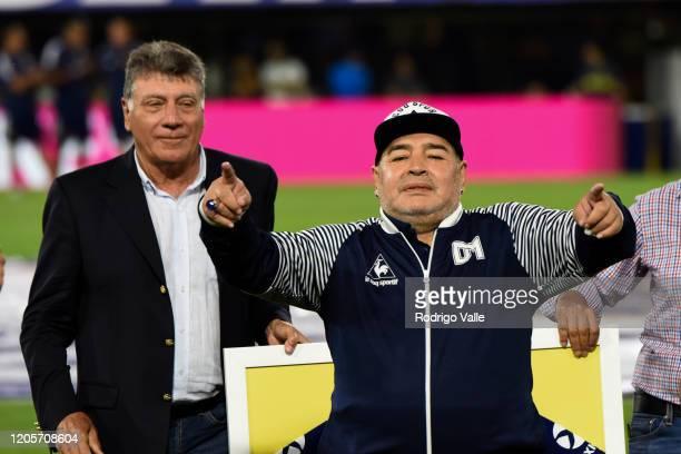Diego Armando Maradona head coach of Gimnasia y Esgrima La PLata waves to the fans along with Miguel Brindisi prior to a match between Boca Juniors...