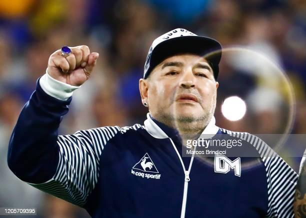 Diego Armando Maradona head coach of Gimnasia y Esgrima La Plata gestures to fans before a match between Boca Juniors and Gimnasia y Esgrima La Plata...