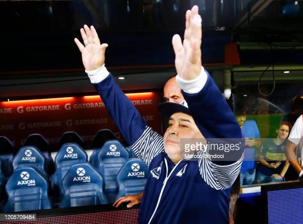 Diego Armando Maradona head coach of Gimnasia y Esgrima La Plata waves to fans before a match between Boca Juniors and Gimnasia y Esgrima La Plata as...
