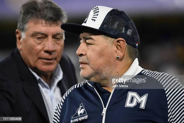 Diego Armando Maradona head Coach of Gimnasia y Esgrima looks on next to Miguel Brindisi prior to a match between Boca Juniors and Gimnasia y Esgrima...