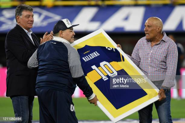 Diego Armando Maradona Head Coach of Gimnasia y Esgrima received a jersey from Miguel Brindisi and Hugo Perotti during a tribute prior to a match...