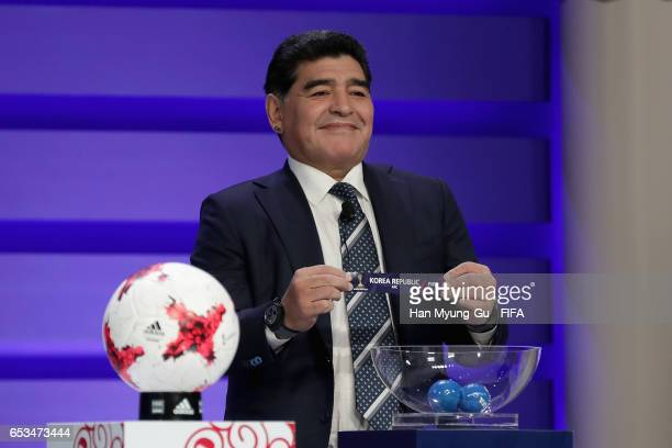 Diego Armando Maradona holds up the name of Korea Republic during the draw for the FIFA U20 World Cup Korea Republic 2017 at Suwon SK Artrium on...