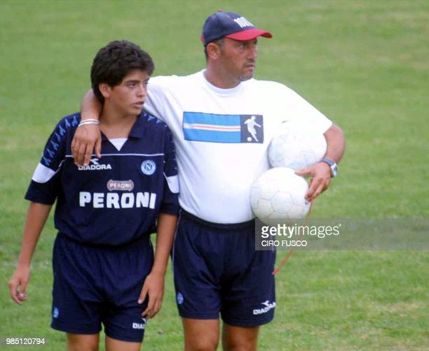 Diego Armando Maradona jr walks with Mr Testa of Napoli training staff after a training session of the Napoli youth team 25 August 2001 in Naples The...
