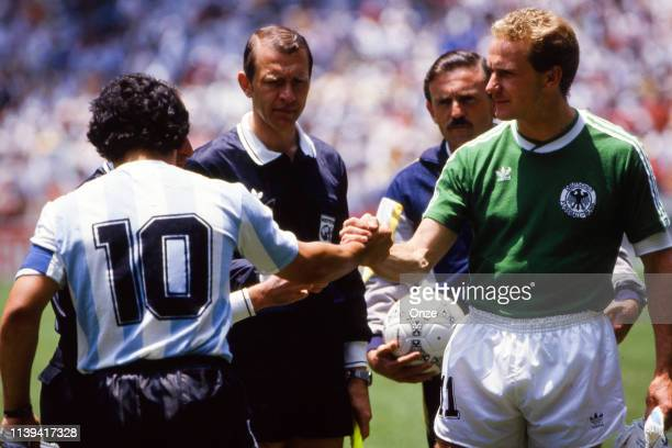 Diego Armando Maradona of Argentina and Karl-Heinz Rummenigge of West Germany during the World Cup Final match between Argentina and West Germany at...