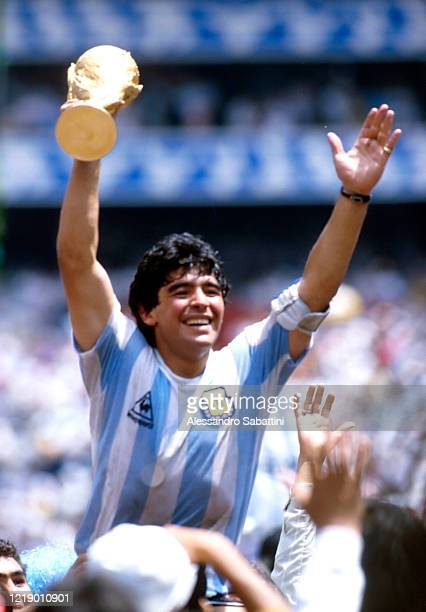 Diego Armando Maradona of Argentina celebrates the victory with the world cup at the end the FIFA World Cup Final 1986 match between Argentina and...