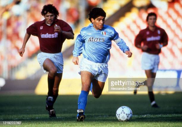 Diego Armando Maradona of SSC Napoli competes for the ball with Giuseppe Carillo of Torino during the Serie A match between Torino and SSC Napoli on...