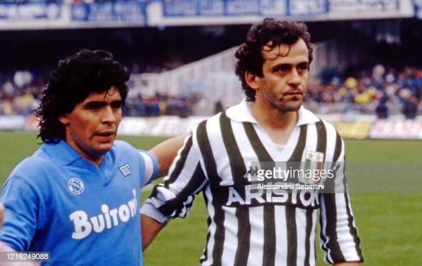 Diego Armando Maradona of SSC Napoli, embraces Michel Platini of Juventus during the Seria A Italy.
