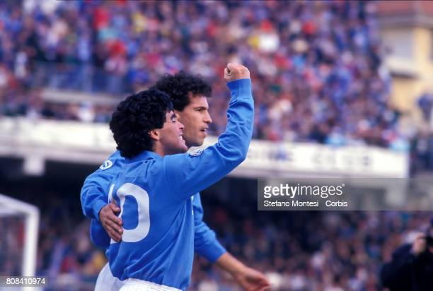 Diego Armando Maradonaexults after scoring a goal along with Careca during a Serie A 8485 match at Stadio San Paolo on 1984 in Naples Italy 'n