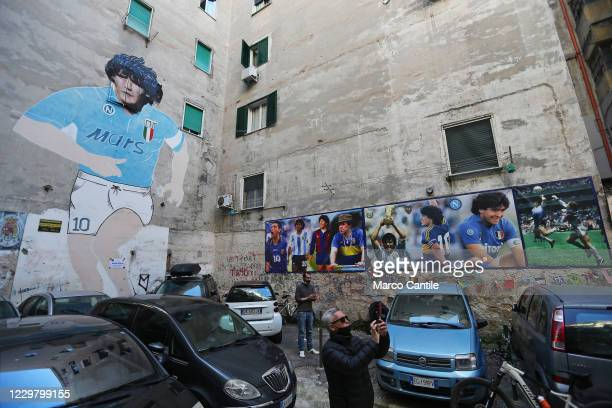 Diego Armando Maradona's giant mural in the Spanish neighborhoods of Naples the day after the death of the famous and legendary Argentine football...