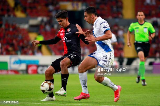 Diego Barbosa of Atlas fights for the ball with Salvador Reyes of Puebla during the quarterfinals first leg match between Atlas and Puebla as part of...