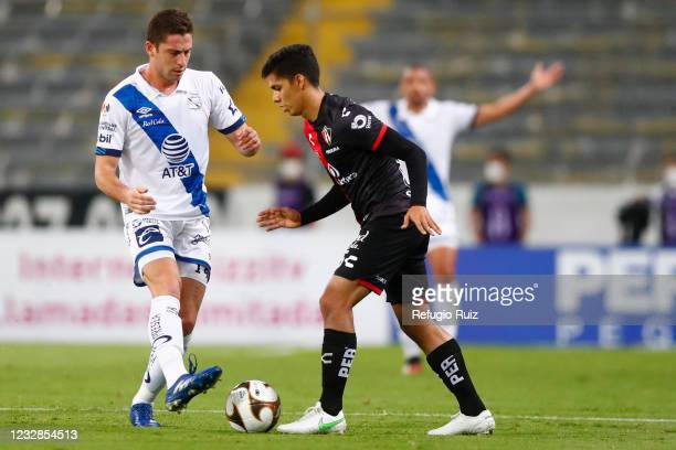 Diego Barbosa of Atlas fights for the ball with Santiago Ormeño of Puebla during the quarterfinals first leg match between Atlas and Puebla as part...