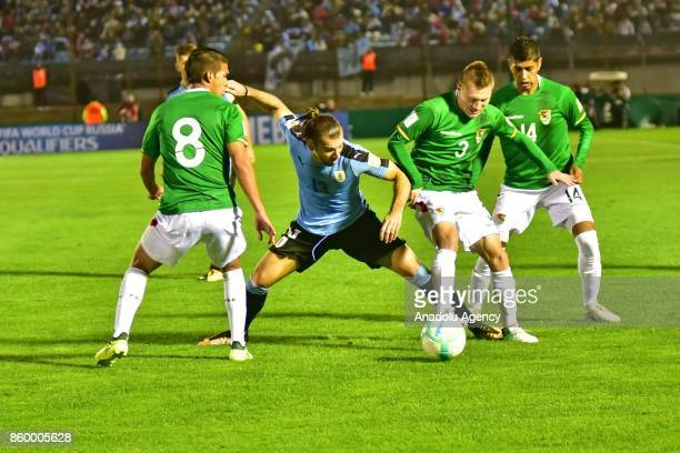 Diego Bejarano Gaston Silva Alejandro Chumacero and Raul Castro vie for the ball during the 2018 FIFA World Cup Qualification match between Uruguay...