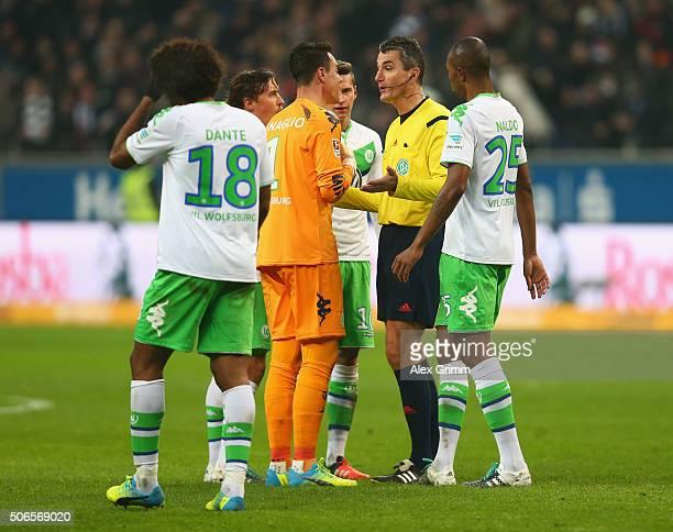 Diego Benaglio of VfL Wolfsburg and team mates appeal to referee Knut Kircher as Alexander Meier of Eintracht Frankfurt scores their first goal...