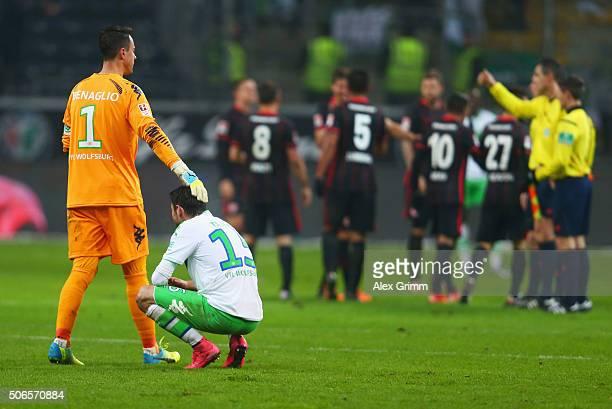 Diego Benaglio of VfL Wolfsburg consloes team mate Christian Trasch after defeat in the Bundesliga match between Eintracht Frankfurt and VfL...