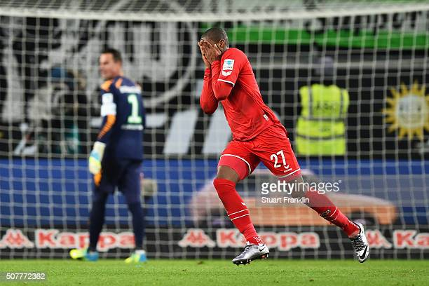 Diego Benaglio of VfL Wolfsburg looks dejected as Anthony Modeste of Cologne celebrates as he scores their first and equalising goal during the...