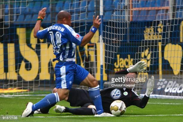 Diego Benaglio of Wolfsburg saves the ball against Joel Epallé of Bochum during the Bundesliga match between VFL Bochum and VfL Wolfsburg at...
