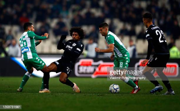 Diego Biseswar of PAOK battles with Anuar Tuhami and Giannis Bouzoukis of Panathinaikos during the Greece SuperLeague match between Panathinaikos FC...