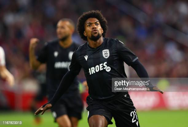 Diego Biseswar of PAOK celebrates scoring his sides first goal during the UEFA Champions League Third Qualifying Round match between Ajax and PAOK...