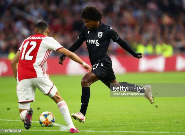Diego Biseswar of PAOK scores his sides first goal during the UEFA Champions League Third Qualifying Round match between Ajax and PAOK Saloniki at...