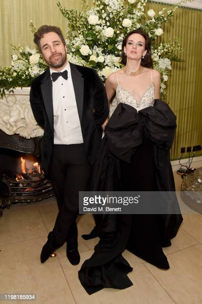 Diego BiveroVolpe and Charlotte Carroll attend the British Vogue and Tiffany Co Fashion and Film Party at Annabel's on February 2 2020 in London...