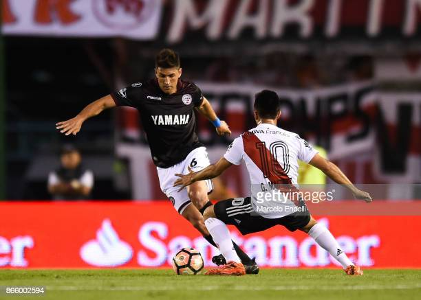 Diego Braghieri of Lanus fights for the ball with Gonzalo Martinez of River Plate during a first leg match between River Plate and Lanus as part of...