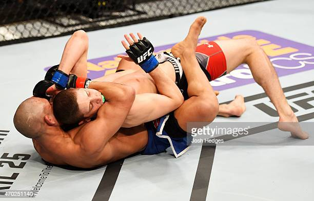 Diego Brandao and Jimy Hettes exchange blows in their featherweight bout during the UFC Fight Night event at Prudential Center on April 18 2015 in...