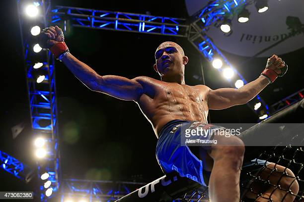 Diego Brandao celebrates defeating Jimy Hettes by TKO in their featherweight bout during the UFC Fight Night event at Prudential Center on April 18...