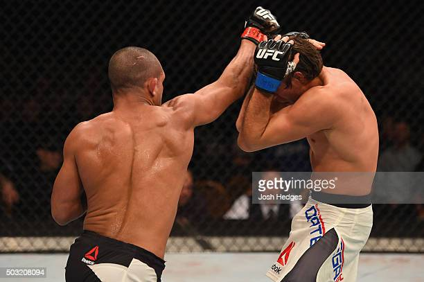 Diego Brandao of Brazil punches Brian Ortega in their featherweight bout during the UFC 195 event inside MGM Grand Garden Arena on January 2 2016 in...
