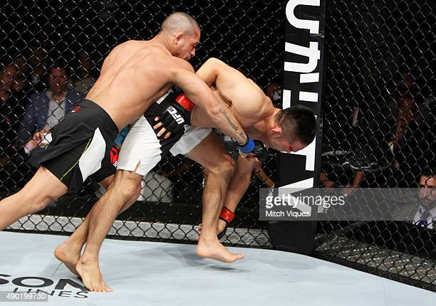 Diego Brandao of Brazil punches Katsunori Kikuno of Japan in their featherweight bout during the UFC event at the Saitama Super Arena on September 27...